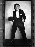 Milton Berle standing Black Suit With Cap