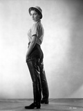 Jean Simmons Posed in White Gingham Short Sleeve Shirt and Black Straight Cut Pants with Leather Sh