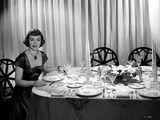 Jane Wyman Seated on the Chair in Black Velvet Short Sleeve Square-Neck Dress and Black Necklace wi