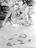 John Barrymore Seated on Rock