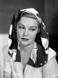 Madeleine Carroll Looking Don in Blouse with Black and White Scarf on Her Head