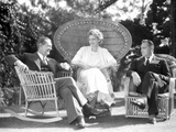 John Barrymore sitting on a Chair with Two Other Friends