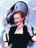 Madeleine Carroll smiling in Black Dress With Hat
