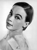 Leslie Caron posed on Side Ways in White Background