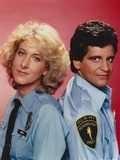 Members of Hill Street Blues Back to Back Pose in Police Attire