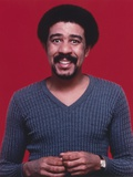 Richard Pryor smiling in Blue Sweater