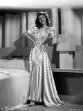Mary Martin on a Printed Silk Dress with Hands on Waist