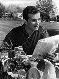 Pat Boone Reading in Formal Attire With Newspaper