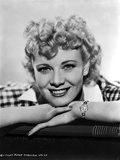 Penny Singleton smiling in Checkered Polo Close Up Portrait with White Background