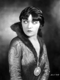 Pola Negri on Printed Dress with Big Pendant