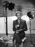 Patricia Neal Holding Tea Cup in Formal Attire