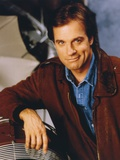 Stephen Collins Reclining Pose wearing Brown Leather Jacket