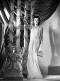 Rosalind Russell Posed in Dress and Holding a Purse