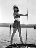 Mary Martin on a Printed Dress standing on a Boat