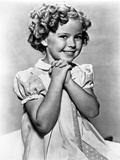 Shirley Temple wearing a Cap-Sleeve House Dress