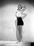 Penny Singleton Posed with Hands on Back of Head in Sexy Sportswear