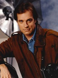 Stephen Collins Posed in a Portrait wearing Brown Leather Jacket