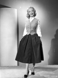 Portrait of Audrey Totter posed in Long Skirt with Heels