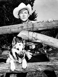 Roy Rogers Behind Logs with a Dog