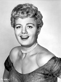Shelley Winters wearing an Off Shoulder Dress and a Pearl Necklace in a Classic Portrait