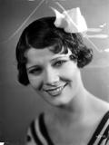 Penny Singleton smiling wearing Flower Hairpin Close Up Portrait