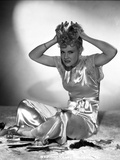 Penny Singleton Seated wearing Silk Dress with Hands on top of Head