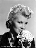 Penny Singleton smiling with Flower Close Up Portrait
