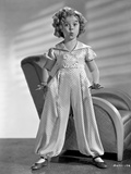 Shirley Temple wearing a Shirtdress with Cap-Sleeve with Matching Pants in Classic Portrait