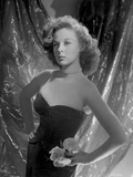 Susan Hayward wearing a Black Tube Dress with Flowers
