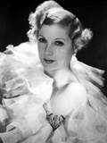 Lilyan Tashman posed in White Gown with Black Background