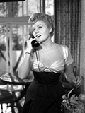 Shelley Winters wearing a Scoop-Neck Dress and Answering the Phone in a Classic Portrait