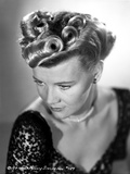 Penny Singleton Looking Down in Black Floral Dress Close Up Portrait