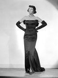 Rosalind Russell Posed in Black Dress with Hands on Hips