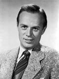 Richard Widmark smiling in Suit
