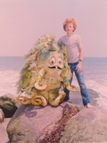 Sigmund & The Sea Monster standing on a Rock in the Sea with the Sea Monster in a Movie Scene