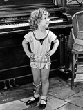 Shirley Temple wearing a Short House Dress