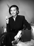 Patricia Neal Seated in Formal Attire with Hat