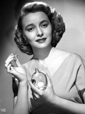 Patricia Neal Holding Perfume in Black and White