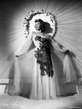 Mary Martin wearing a Lace Dress and Swaying her Skirt