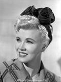 Penny Singleton smiling wearing Flower Head Band Close Up Portrait
