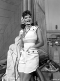 Mary Martin wearing a White Dress and a Scarf on Her Head