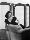 Ruth Roman Posed on Couch wearing Black Gown