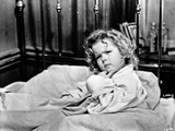 Shirley Temple sitting on the Bed in a Portrait