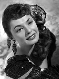 Ruth Roman smiling in Black Gown