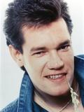 Randy Travis smiling in Close Up Portrait wearing Blue Denim Jacket