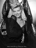 Penny Singleton smiling in Black Floral Dress Portrait