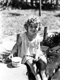 Shirley Temple sitting on the River Bank in aClassic Portrait