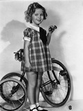 Shirley Temple Holding Her Tricylce Bike