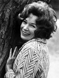 Shirley MacLaine Leaning and smiling on Tree