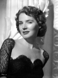 Polly Bergen smiling in a Portrait in Black Lace Dress